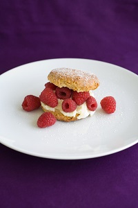 healthy dessert with fruit on white plate