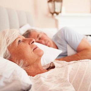 senior-lying-away-in-bed.jpg