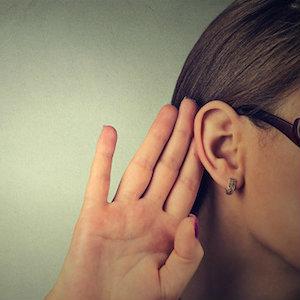 woman-hand-by-ear.jpg