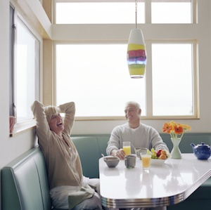 mature-couple-laughing-breakfast.jpg